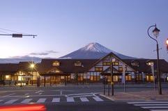 Mt Fuji and train station at dawn. Train Station in Kawaguchi, Mt Fuji on the background. Japan royalty free stock image