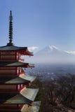 Mt. Fuji viewed from behind red Chureito Pagoda Stock Photo