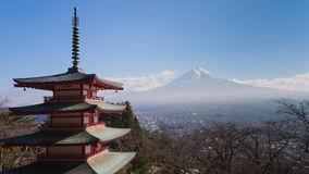 Mt. Fuji volcano viewed from behind red Chureito Pagoda Royalty Free Stock Photography