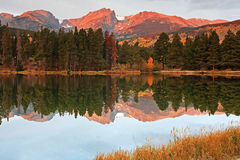 Mt. Hallet reflecred in Sprague Lake at Rocky Mountain N.P. Early morning reflection of Hallet Peak in Sprague Lake at Rocky Mountain National Park Stock Images