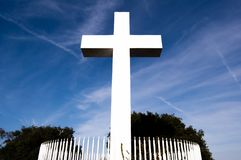 Mt Helix cross against cloudy sky. The cross memorial at Mount Helix park in San Diego, California in front view with wispy clouds Stock Images