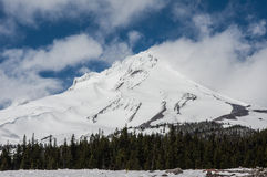 Mt Hood with clouds and blowing snow Royalty Free Stock Photography