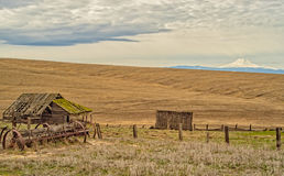 Mt Hood Homestead. Discarded farm equipment and a long abandoned home are what remain of an old homestead in the Dufur area of Central Oregon, south of The royalty free stock photo