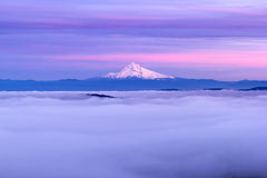 Mt Hood and Low Cloud Banks at Sunset. Mt Hood and Low Foggy Clouds over City of Portland in Oregon at Sunset Stock Images