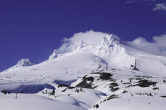 Mt. Hood, Oregon. Mt. Hood covered in snow with ski lifts stock photos