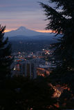 Mt. Hood and Portland at Dusk. Portland, Oregon darkens at sunset with Mt. Hood in the background, as seen from the Southwest Hills Royalty Free Stock Image