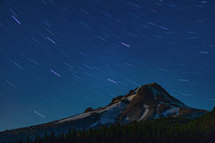 Mt. Hood Star Rotation. The stars rotate as Mt. Hood stays anchored in this 10 minute exposure Royalty Free Stock Photos