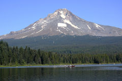 Mt. Hood & Trillium Lake. Boaters enjoy a clear day on Trillium Lake in Oregon. On the background is Mt. Hood and the vast wilderness area Royalty Free Stock Images