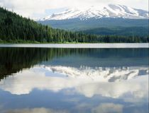 MT.HOOD AND TRILLIUM LAKE. Mt. Hood and Trillium Lake with boats with tourist and fisherman, Oregon Stock Image
