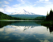 MT.HOOD AND TRILLIUM LAKE. Mt. Hood and Trillium Lake with boats with tourist and fisherman, Oregon Royalty Free Stock Photos