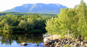 Mt. Katahdin, Maine. The view of Mt. Katahdin in Baxter State park, Maine. Also, a fly-fisherman casting his rod Royalty Free Stock Photo