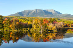 Mt. Katahdin in State of Maine. Landscape photo of Mt Katahdin in Baxter State Park, Maine displaying fall colors and reflections with clear blue sky Royalty Free Stock Images