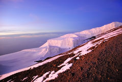 Mt Kilimanjaro. Melting glaciers of the mt Kilimanjaro mountain shown at beautiful vivid sunrise, Tanzania Stock Image