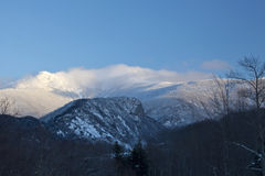 Mt. Lafayette in clouds. Snow-clad Mt. Lafayette in New Hampshire with clouds around the summit Stock Images