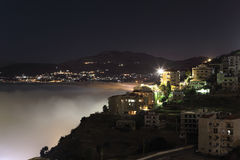 Mt Lebanon at night with rolling fog Royalty Free Stock Image