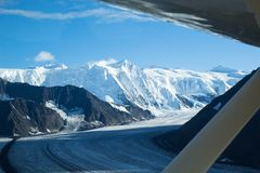 Mt Marcus Baker and the Neve of the Matanuska Glacier in the Chugach Mountains of Alaska from small bush plane. Bush plane wing looking out over the Matanuska stock photography