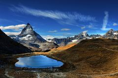 Mt Matterhorn reflected in Riffelsee Lake Zermatt Canton of Vala. Is Switzerland Royalty Free Stock Images