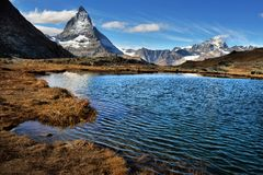 Mt Matterhorn reflected in Riffelsee Lake Zermatt Canton of Valais royalty free stock images