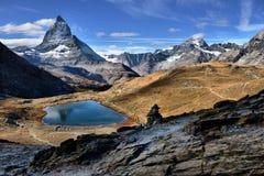 Mt Matterhorn reflected in Riffelsee Lake Zermatt Canton of Vala Royalty Free Stock Photos