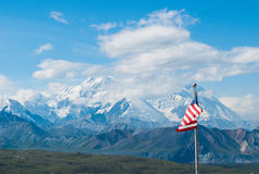 Mt. McKinley. As seen in Denali national park on a clear day with the American flag Stock Photos