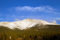 Mt Meeker in Rocky Mountain National Park. Mt Meeker after a fresh fallen snow stands above the pine trees in Rocky Mountain National Park in Estes Park Colorado Stock Photography