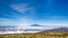 Mt. Meru, Kilimanjaro National Park, Tanzania, Africa. Mt.Meru rises above the morning clouds, Machame-Mweka Route, Kilimanjaro National Park, near Arusha Royalty Free Stock Photos