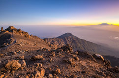 Mt Meru & Kilimanjaro at sunrise. Mount Meru with Mt Kilimanjaro in the distance near Arusha in Tanzania. Africa. Mt Meru is located 60 kilometres west of Mount Royalty Free Stock Photos