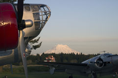 Mt. Rainer Vintage Aircraft. Sunset view of Mt. Rainer from Joint Base Lewis-McChord (JBLM), McChord Airfield with Vintage Aircraft and Control Tower in royalty free stock photo