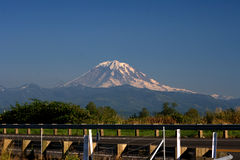 Mt. Rainier across the highway. In this magnificent scenic view of one of Washington State and the Seattle Area's most recognizeable landmarks royalty free stock images