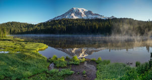 Mt Rainier at Reflection Lakes Sunrise. This is the picture of Mt Rainier at Reflection Lakes in the morning with fog and mist at Mt Rainier National Park Royalty Free Stock Images