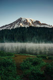 Mt Rainier at Reflection Lakes Sunrise. This is the picture of Mt Rainier at Reflection Lakes in the morning with fog and mist at Mt Rainier National Park Stock Photos