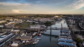 Aerial View Thea Foss Waterway Tacoma Washington Mt Rainier Visible. Mt Rainier stands in the background above the tide flats and the Port of Tacoma royalty free stock image
