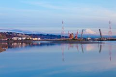 Mt.Ranier and Tacoma port with cranes and bridge. Royalty Free Stock Images