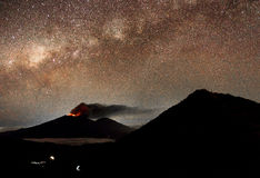 Mt Raung with the milky way above it stock photography