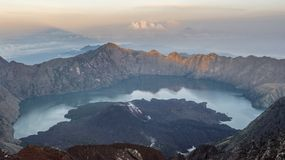 Mt Rinjani at sunrise, one of the active volcano in Indonesia is a famous destination for adventure seekers to reach summit 3726 m. Mt Rinjani, one of the active Stock Images