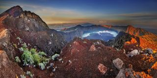 Mt Rinjani at sunrise, one of the active volcano in Indonesia is a famous destination for adventure seekers to reach summit 3726 m Stock Image