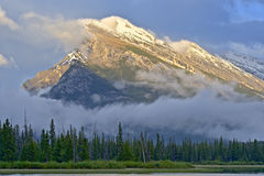 Mt Rundle in heavy winds Stock Images