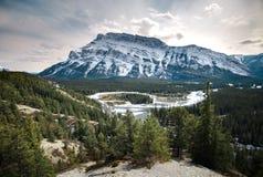 Mt Rundle stands proud beyond the Hoodoos of Banff, Alberta stock image