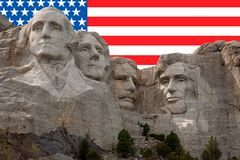 Mt Rushmore. Mt. Rushmore in the Black Hills of South Dakota with the American Flag in background Stock Image