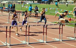 Mt. Sac relays 2015 track and field meet, 100 meter high hurdles. Last to be held at historic  Hilmer Lodge Stadium. Mt. San Antonio 2015 track meet relays high Royalty Free Stock Image