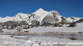 Mt Saentis och sjö Schwendi i vinter Royaltyfri Bild