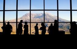 Mt. Saint Helens' Johnston Ridge Observatory. Tourists view Mt. Saint Helens through the windows of the Johnston Ridge Observatory. Washington State, USA. Minor royalty free stock image