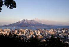 Mt Sakurajima erupts over Kagoshima City stock photos