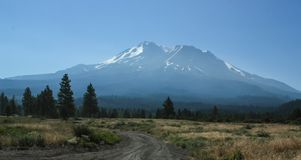 Mt. Shasta in Summer with rests of snow show impact of global wa stock image