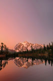 Mt Shuksan with the alpine sunset glow vertical. Vertical shot of Mount Shuksan with the alpine glow after sunset from Picture Lake stock photography