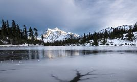 Mt Shuksan at frozen Picture Lake. stock images