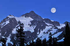 Mt Shuksan and full moon. Mount Shuksan and full moon, Mt. Baker-Snoqualmie National Forest stock photo