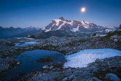Mt Shuksan and the rising moon, Washington state cascade range Stock Images