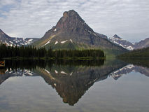 Mt Sinopah Reflected. This image of Sinopah reflected in Two Medicine Lake was taken in Glacier National Park Royalty Free Stock Photo