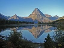 Mt Sinopah Reflection. This image shows Mt Sinopah reflected in Pray Lake during the early morning hours in the Two Medicine area of Glacier National Park Stock Image